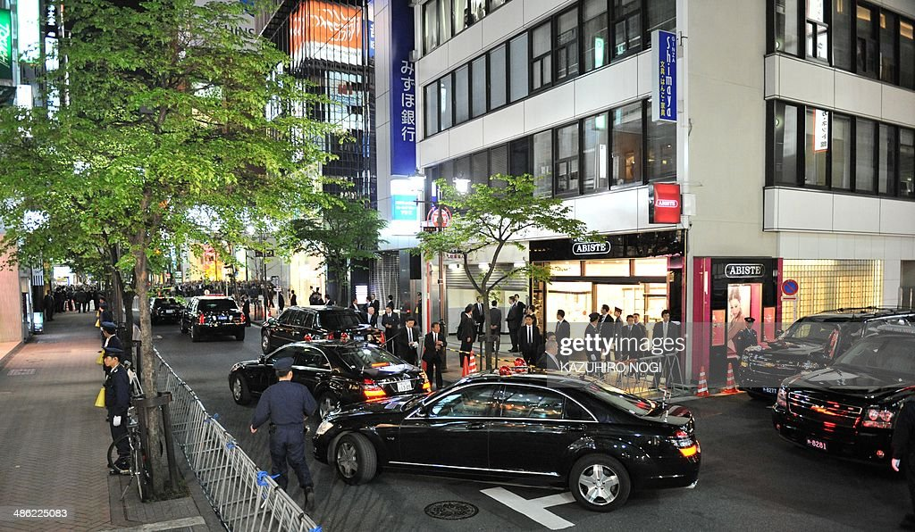 The motorcade of US President Barack Obama arrives at Sukiyabashi Jiro restaurant in Tokyo on April 23, 2014. Obama landed in Tokyo on April 23 to launch an Asian tour dedicated to reinvigorating his policy of 'rebalancing' US foreign policy towards a dynamic Asia. Sukiyabashi Jiro's less-than-plush surroundings notwithstanding, it is the proud possessor of three Michelin stars, and people flock to pay a minimum $300 for 20 pieces of sushi chosen by the 88-year-old patron, Jiro Ono.