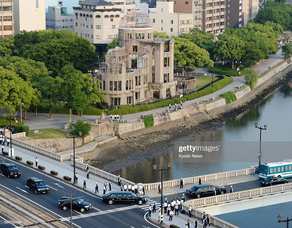 The motorcade of U.S. President Barack Obama proceeds across the Aioi Bridge -- the aiming point for the 1945 U.S. atomic bomb attack -- in Hiroshima on May 27, 2016, after the president made a historic visit to the Peace Memorial Park. The Atomic Bomb Dome can be seen in the background.