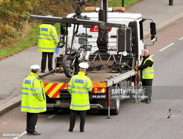 The motorcycle of Tottenham goalkeeper Carlo Cudicini is loaded onto a recovery truck after a crash with a car on Forest Road Walthamstow east London