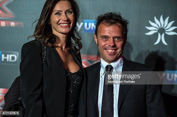 'The motorcycle road racer Loris Capirossi with her wife Ingrid Tence during the final of the the talent show X Factor Assago Italy 11th December...