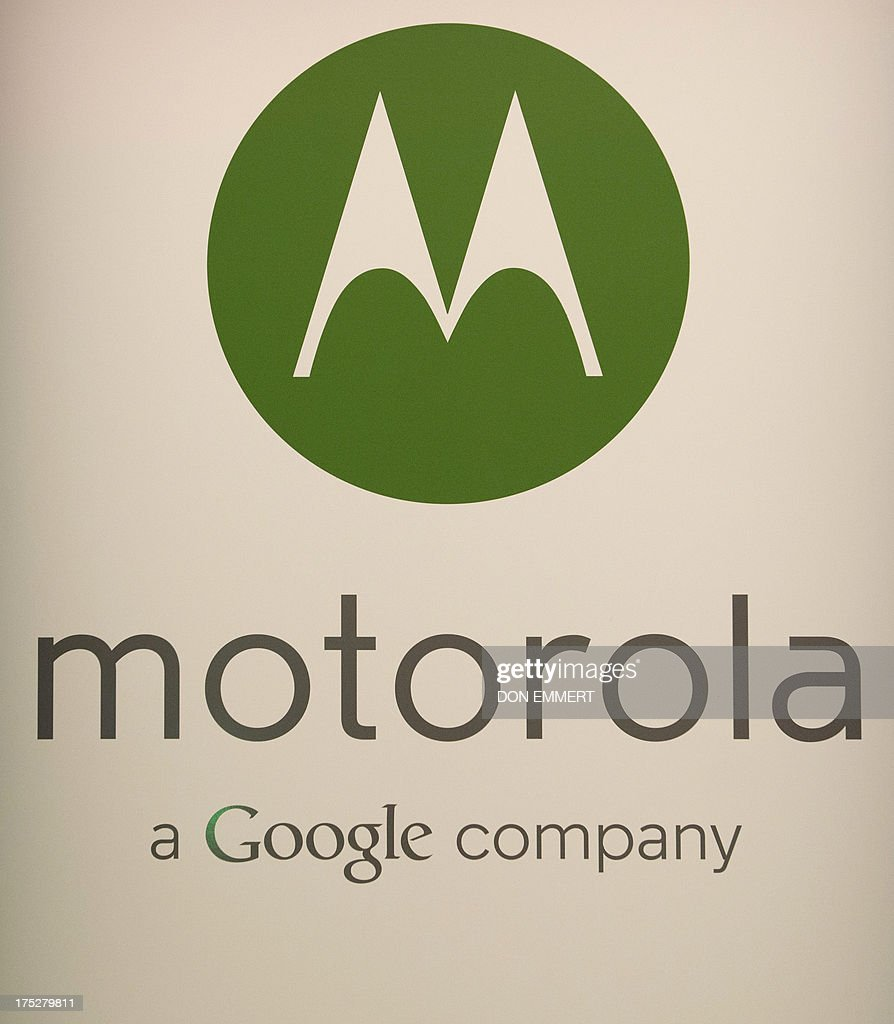 The Motorola logo is displayed as the American-manufactured Motorola Moto X smartphone is unveiled August 1, 2013 at a news conference in New York. The Google-owned company said users will be able to customize a number of the parts on the Moto X, including various colors and materials such as wood. AFP PHOTO/Don Emmert