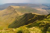 The mountain peak of Cribyn as seen from Pen-Y-Fan on a Spring afternoon. Situated in the Brecon Beacons national park, Cribyn makes up park of the Pen-Y-Fan horseshoe walk.