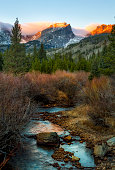 Sunlight hits the peaks of the mountain tops in Rocky Mountain National Park