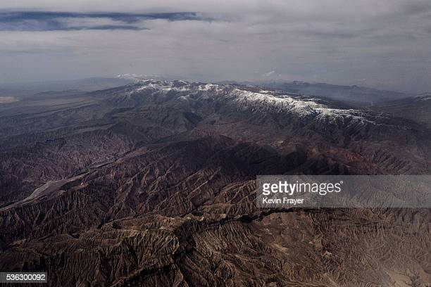The mountains and grasslands of the Tibetan Plateau are seen from the air in the Yushu Tibetan Autonomous Prefecture of Qinghai province on May 24...