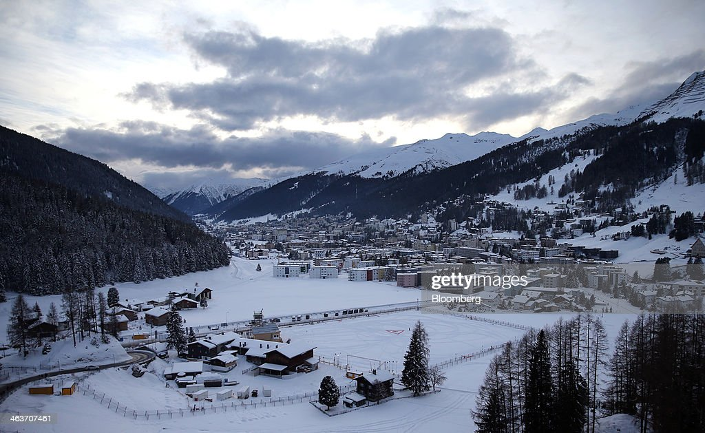 The mountains and town of Davos are seen from the balcony at the 'Studio Grigio' bar, at the InterContinental hotel Davos, operated by InterContinental Hotels Group Plc (IHG) in Davos, Switzerland, on Saturday, Jan. 18, 2014. Next week the business elite will gather in the Swiss Alps for the 44th annual meeting of the World Economic Forum (WEF) in Davos for the five day event which runs from Jan. 22-25. Photographer: Simon Dawson/Bloomberg via Getty Images