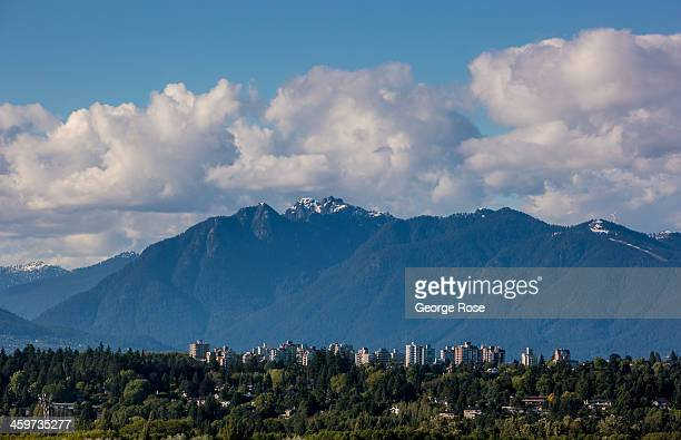 The mountains of North Vancouver are viewed from the International Airport on June 3 2013 in Vancouver British Columbia Canada Vancouver a seaport...