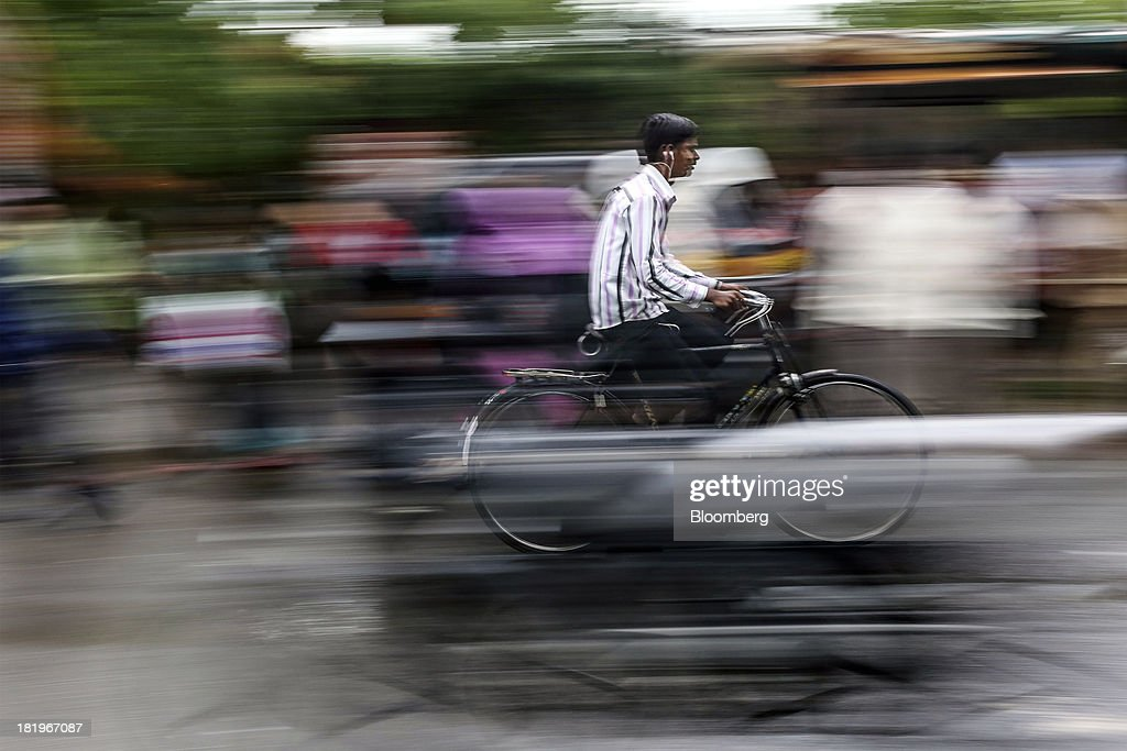 The movement of passing pedestrians and vehicles is seen as a cyclist travels along a road beside the Wockhardt Ltd. manufacturing facility in the Chikalthana industrial area in Aurangabad, India, on Monday, Sept. 16, 2013. Wockhardt currently controls about 26 percent of the U.S. market for metoprolol, a generic version of the heart pill sold by London-based AstraZeneca Plc under the brand name Toprol-XL, according to Needham & Co. Metoprolol alone makes up about 14 percent of the company's 56 billion rupees in annual revenue. Photographer: Dhiraj Singh/Bloomberg via Getty Images