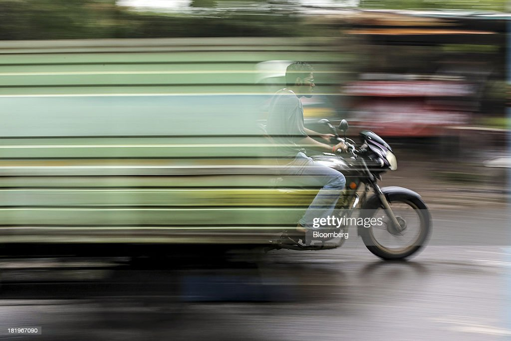 The movement of passing vehicles is seen as a motorcyclist travels along a road beside the Wockhardt Ltd. manufacturing facility in the Chikalthana industrial area in Aurangabad, India, on Monday, Sept. 16, 2013. Wockhardt currently controls about 26 percent of the U.S. market for metoprolol, a generic version of the heart pill sold by London-based AstraZeneca Plc under the brand name Toprol-XL, according to Needham & Co. Metoprolol alone makes up about 14 percent of the company's 56 billion rupees in annual revenue. Photographer: Dhiraj Singh/Bloomberg via Getty Images