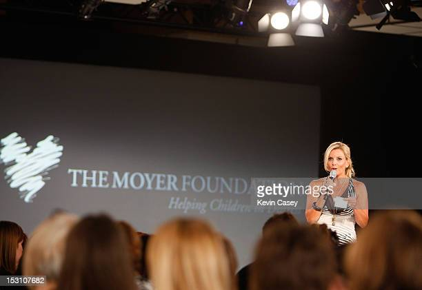 The Moyer Foundation's Karen Moyer speaks at the beginning of Fashion's Front Row Presented By Vogue At Bellevue Fashion Week Benefitting The Moyer...