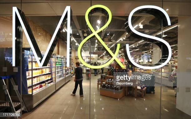 The MS company logo is seen on a window inside a Marks Spencer Group Plc food hall in the Westfield Stratford City retail complex in London UK on...