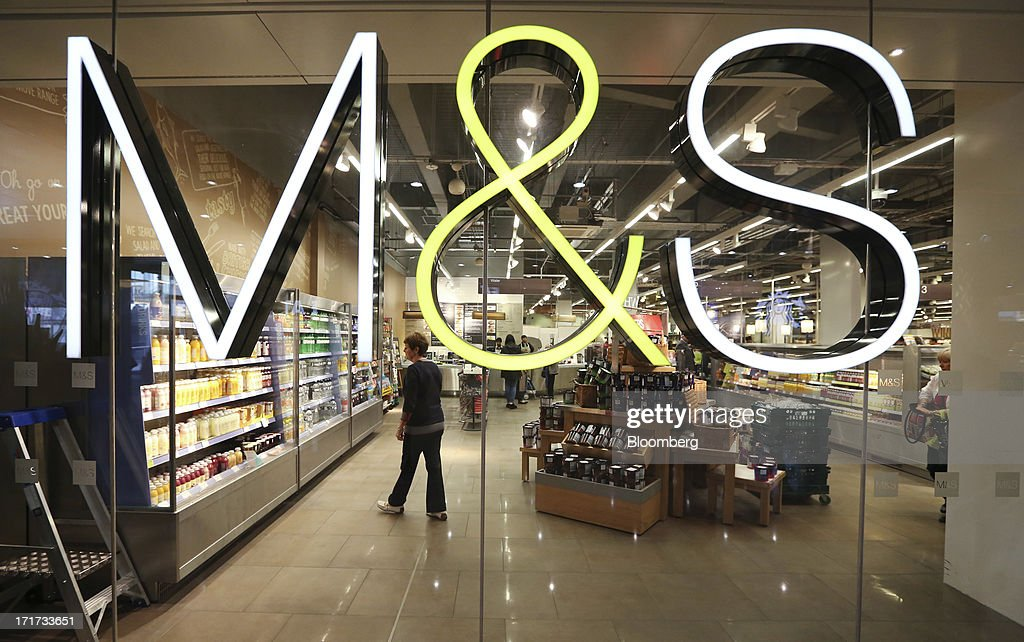 The M&S company logo is seen on a window inside a Marks & Spencer Group Plc (M&S) food hall in the Westfield Stratford City retail complex in London, U.K., on Thursday, June 27, 2013. U.K. retail sales rose more than economists forecast in May as consumers spent more online and food sales increased at their fastest pace for more than two years. Photographer: Chris Ratcliffe/Bloomberg via Getty Images