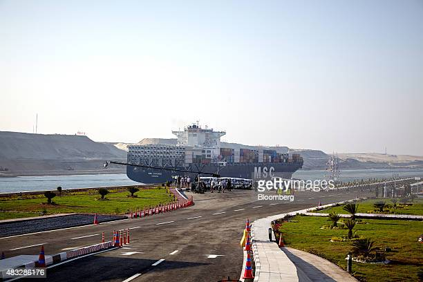The MSC Chicago container ship passes through the New Suez Canal operated by the Suez Canal Authority during the official opening ceremony in...