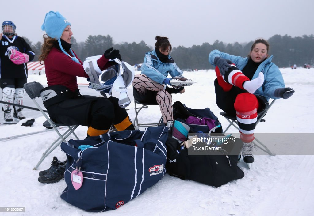 The MsConduct team from Chicago prepares for their game at the 2013 USA Hockey Pond Hockey National Championships on February 10, 2013 in Eagle River, Wisconsin. The three day tournament features 2,400 participants from 30 states playing a round robin tournament on 28 rinks laid out on Dollar Lake.