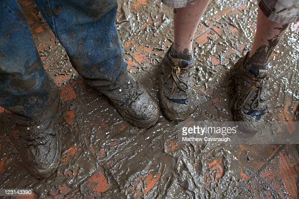 The mud covered shoes of two clean up volunteers are pictured where Tropical Storm Irene caused severe flooding in the town's center on August 31...