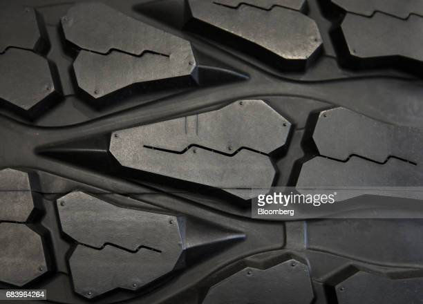 The Mud Grappler truck tire is displayed at the Toyo Tire Rubber Co plant in Iwanuma Miyagi Japan on Tuesday May 16 2017 Japan is scheduled to...