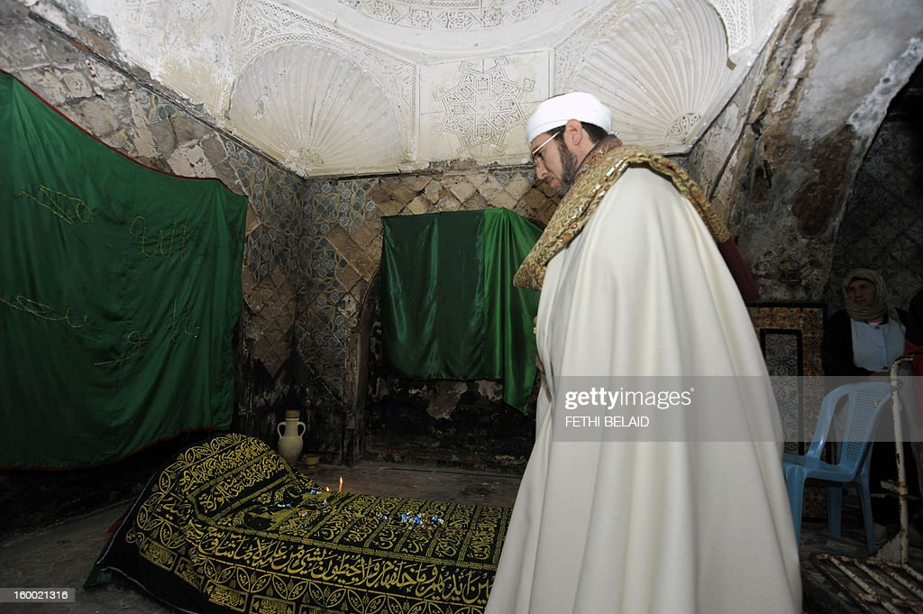 The Mufti of Sidi Bou Said visits the main chamber of the mausoleum in Tunisia on January 24, 2013. The renovation project of the recently torched mausoleum is mid-way through, as it was prepared for a modest reopening to welcome visitors commemorating the birth of Prophet Mohammed, known in Arabic as 'al-Mawlid al-Nabawi'. In the 35th such attack in seven months, unidentified assailants hurled Molotov cocktails at the Sidi Ahmed Uwerfelli shrine in Akuda, 140 kilometres (85 miles) south of Tunis.