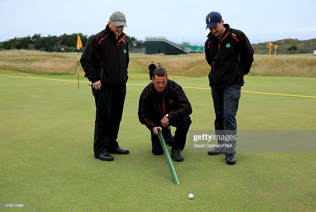 The Muirfield Course Manager Colin Irvine and staff from STRI the R&A Agronomists checking the pace of the greens with a 'Stimpmeter' during a practice round as a preview for the 2013 Open Championship at Muirfield on July 10, 2013 in Gullane, Scotland.