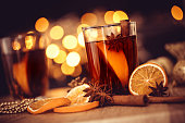 Mulled wine in night celebration of  New Year party and delicious Christmas drink for autumn and winter season