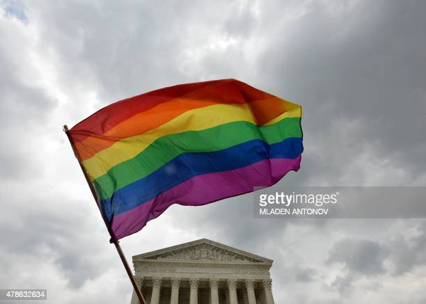 The multicolored flag of the gay rights movement is seen outside the Supreme Court in Washington DC on June 26 2015 after its historic decision on...