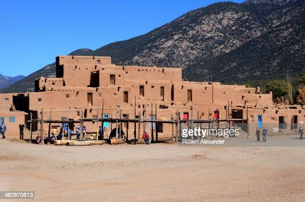 The multistoried adobe residential complex is an historic landmark in Taos Pueblo an ancient Native American community located near the modern city...