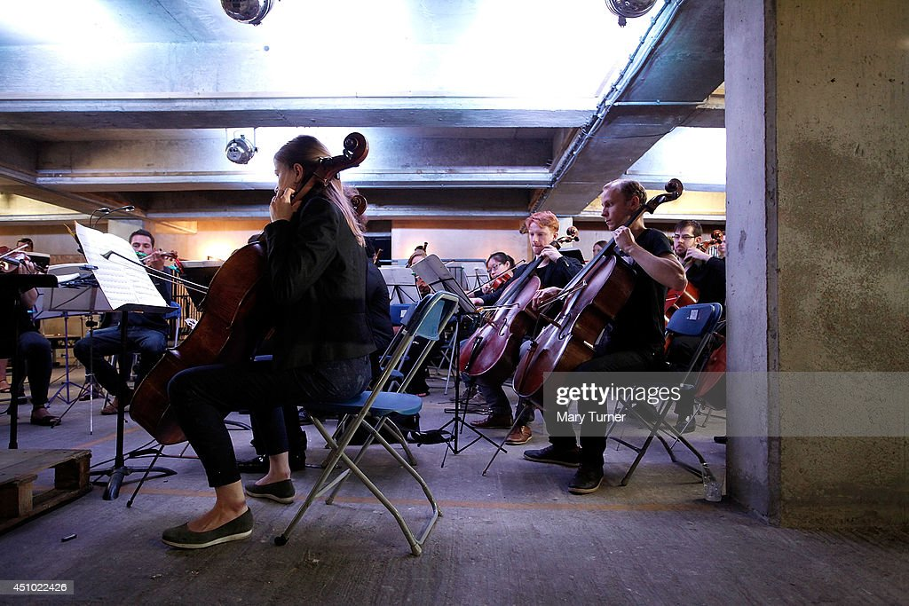 The MultiStory Orchestra perform Jean Sibelius' 5th Symphony at the Peckham Rye Car Park on June 21 2014 in London England The performance is one of...