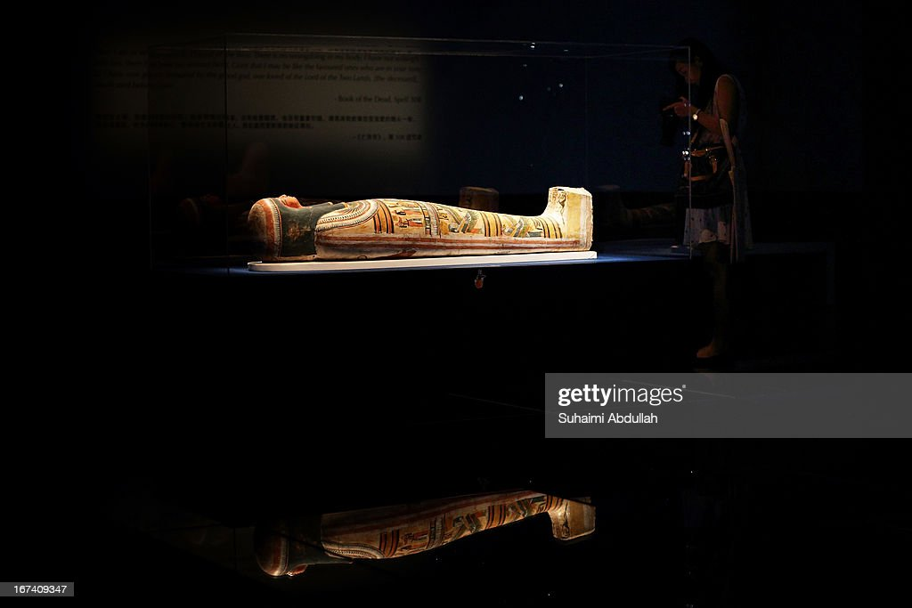 The mummy of Nesperennub in cartonnage case is displayed during a media preview of the Mummy: Secrets of the Tomb exhibition at ArtScience Museum on April 25, 2013 in Singapore. The exhibition includes more than 100 artifacts and six mummies from the heralded ancient Egyptian collection of the British Museum. Among the mummies displayed is the Egyptian temple priest, Nesperennub who lived 3,000 years ago. The exhibition will run from April 27 till November 4, 2013.