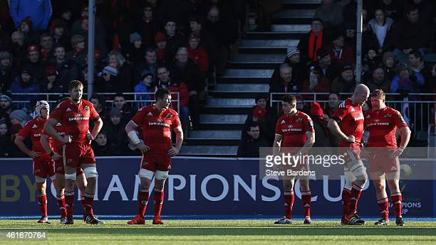The Munster plasyers look dejected as they wait for a conversio attempt during the European Rugby Champions Cup pool one match between Saracens and...