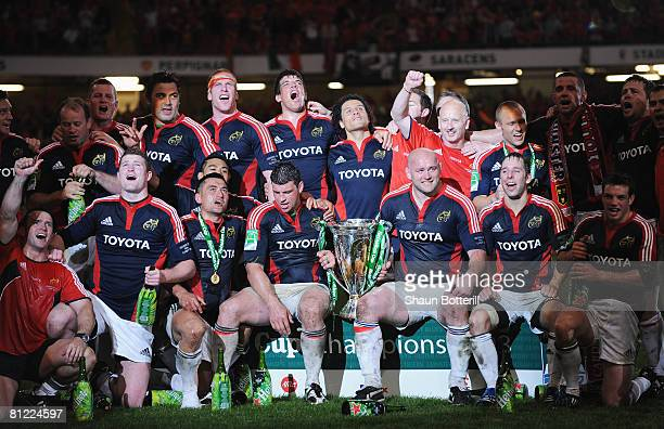 The Munster players celebrate with the trophy following victory in the Heineken Cup Final between Munster and Toulouse at the Millennium Stadium on...