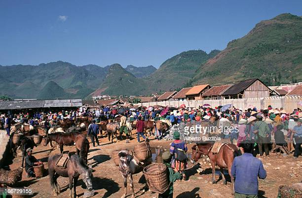 The Muong Khuong weekly open market attracts hundreds of tribesmen every Sunday The tribes people of north Vietnam often gather in these kind of...
