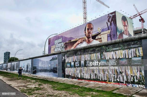 The murals that decorate a surviving portion of the Berlin Wall known as the East Side Gallery the former border between Communist East and West...