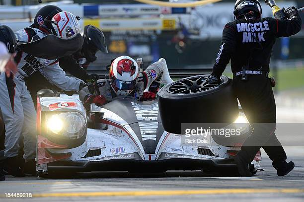 The Muscle Milk Pickett Racing HPD in for a pit stop as Lucas Luhr of Germany prepares to leave the car and codriver Romain Dumain of France takes...