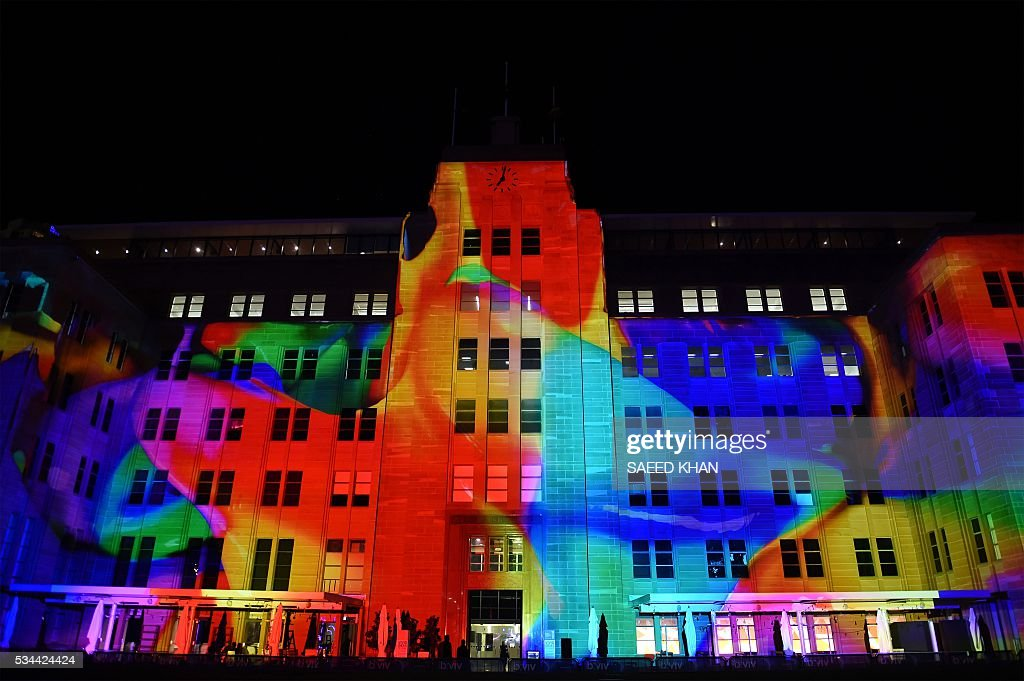 The Museum of Contemporary Art building is lit up during the media preview of Vivid Sydney in Sydney on May 26, 2016. Vivid Sydney, an annual festival of light, music and ideas runs from May 27 to June 18. / AFP / SAEED