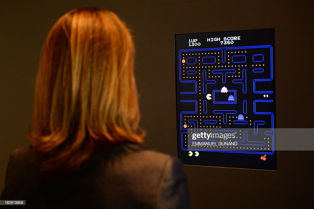 The Museum of Modern Art (MoMA) Senior Curator of Architecture and Design Paola Antonelli plays the video game Pac-Man during a preview of the MoMa's exhibition featuring 14 acquired video games in New York, March 1, 2013. MoMA acquired 14 video games entering its collection as part of an ongoing research on interaction design.