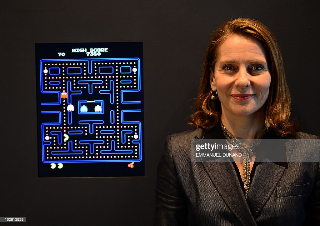 The Museum of Modern Art (MoMA) Senior Curator of Architecture and Design Paola Antonelli poses next to the video game Pac-Man during a preview of the MoMa's exhibition featuring 14 acquired video games in New York, March 1, 2013. MoMA acquired 14 video games entering its collection as part of an ongoing research on interaction design.
