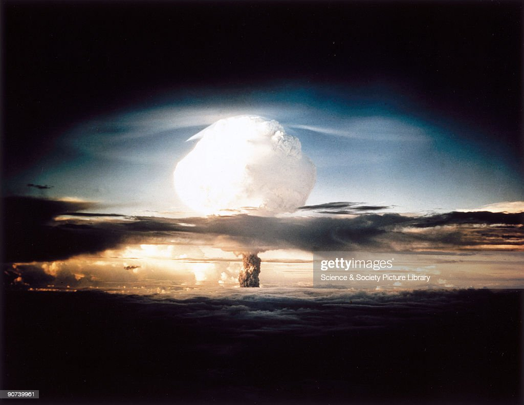 The mushroom cloud produced by the first explosion by the Americans of a hydrogen bomb at Eniwetok Atoll in the South Pacific. Known as Operation Ivy, this test represented a major step forwards in terms of the destructive power achievable with atomic weapons. The hydrogen, or fusion, bomb used a fission device similar to those dropped on Hiroshima and Nagasaki at the end of World War II, detonated inside a container containing deuterium. The high temperatures involved set off a fusion reaction in the deterium, releasing vast amounts of energy. The yield of the weapon was 10.4 megatonnes, more than the total of all the high explosive detonated in the entire duration of the Second World War.