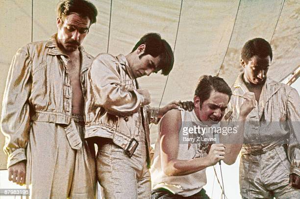 The music group Sha Na Na performing onstage at the Woodstock Music and Arts Fair in Bethel New York August 18 1969 They are wearing goldpainted...