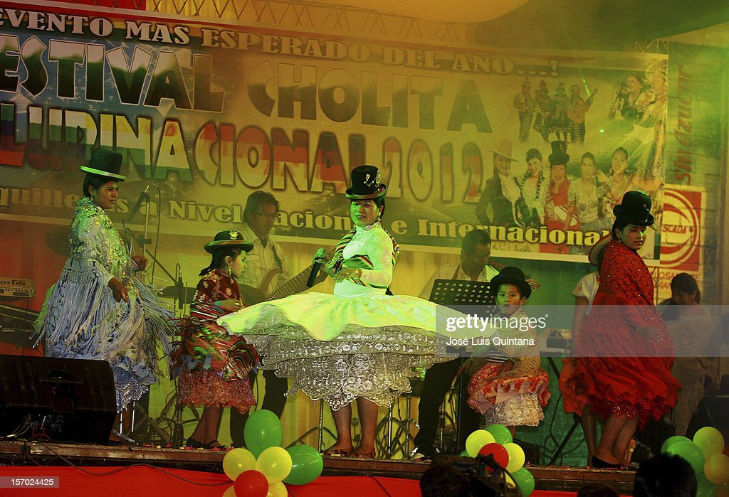 The musical group 'Vilmita Corazon' of La Paz participates during the first Cholita Plurinational Festival 2012 at the Coliseum Multifunctional satellite city of the city of El Alto on November 24, 2012 in La Paz, Bolivia.