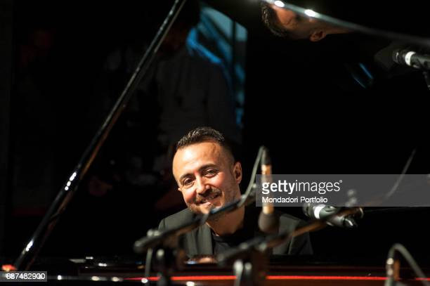 The musician Gioni Barbera accompanying the lyricist Mogol at the piano during the meeting Viaggio nella canzone italiana held by Panorama d'Italia...