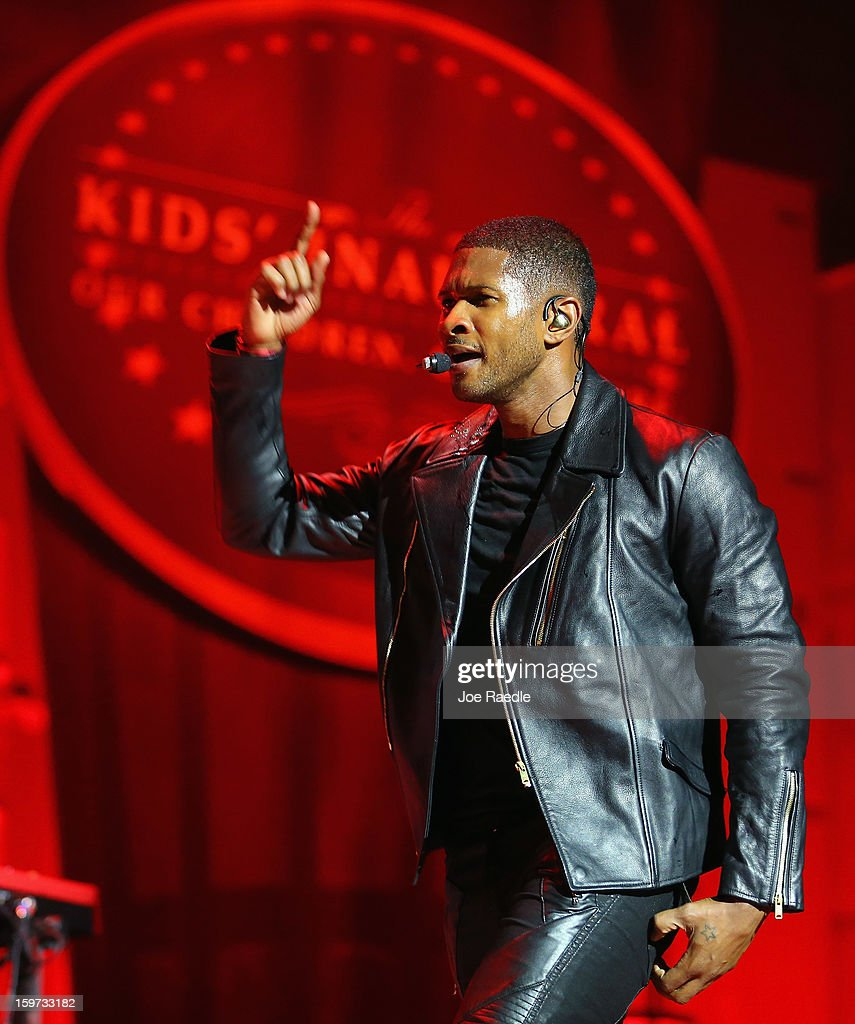 The musician Usher sings during the children's concert at the Washington Convention Center to celebrate military families on January 19, 2013 in Washington, DC. The U.S. capitol is preparing for the second inauguration of U.S. President Barack Obama, which will take place on January 21.