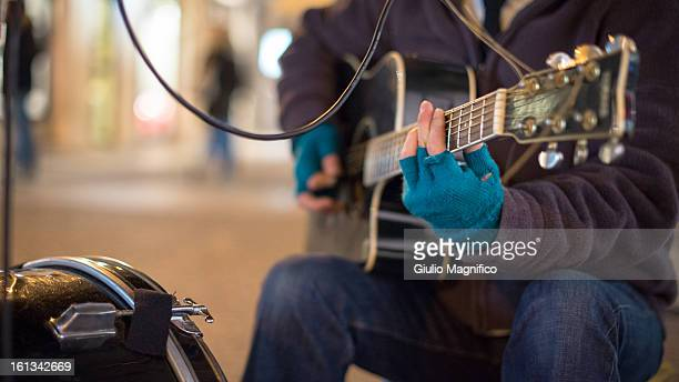 The musician with the blue gloves