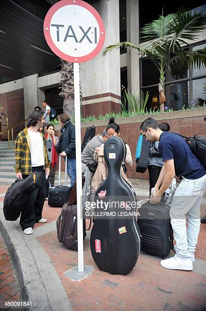The musicians who accompany Argentine musician Charly Garcia leave a hotel in Bogota on November 16 to go to the airport and return to Buenos Aires...
