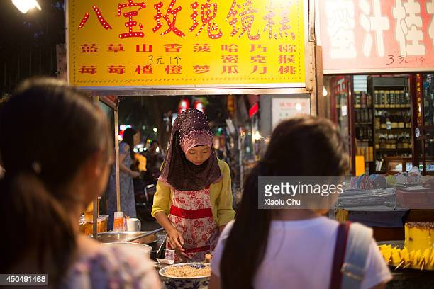 The Muslim cooks halal food at the famous Muslim Snack Street XiÕan is the capital of Shanxi province and the economic cultural education center of...
