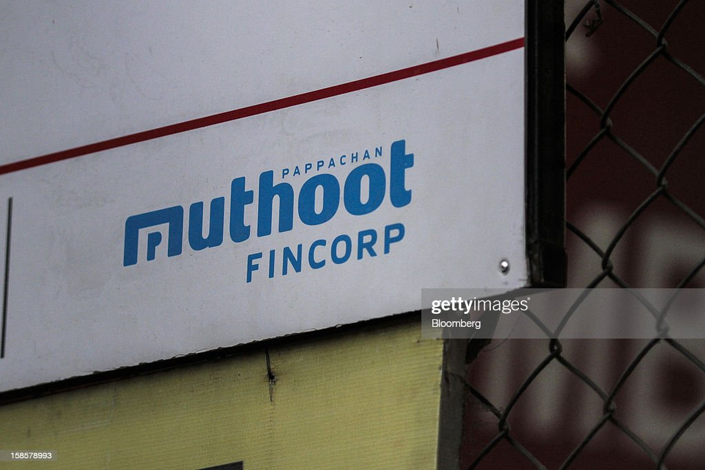 The Muthoot Fincorp Ltd. logo is displayed at one of the company's branches in Mumbai, India, on Tuesday, Dec. 18, 2012. Assets at non-bank lenders such as Muthoot have increased 20 percent annually for the past five years to $670 billion, according to a November report by the Financial Stability Board. Photographer: Dhiraj Singh/Bloomberg via Getty Images