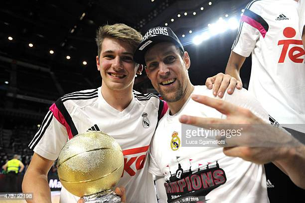 The MVP Andres Nocioni #6 of Real Madrid and the MVP of Junior Tournament Luka Doncic pose after victory against Olympiacos Piraeus during the...