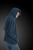 The mysterious man posing with grey hoodie on a black background, Have clipping paths.