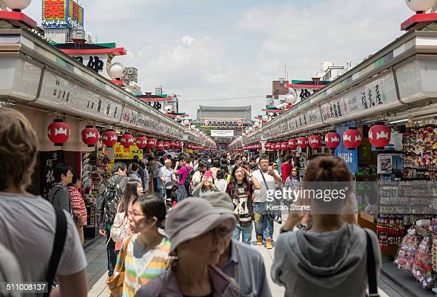 The Nakamise shopping street in old Tokyo with many tourists shopping for souvenirs Asakusa Tokyo Japan