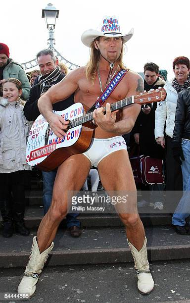 The Naked Cowboy aka Robert Burck launches the 'You Can do Anything' competition on the Ha'penny Bridge on January 25 2009 in Dublin Ireland