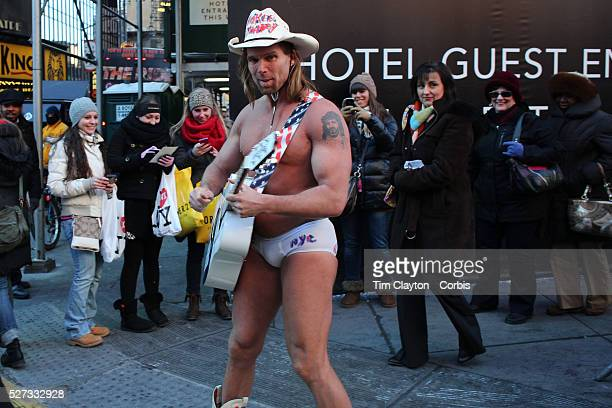 The Naked Cowboy makes the most of the influx of people during Super Bowl week activities in Times Square New York USA 29th January 2014 Photo Tim...