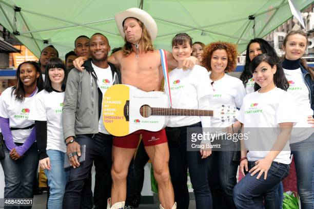 The Naked Cowboy officially changes his underwear to Fruit of the Loom's new Boxer Briefs at Times Square on May 6 2014 in New York City