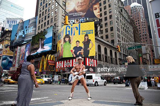 The 'Naked Cowboy' plays his guitar in Times Square on March 23 2012 in New York City A recent study found that the Times Square district contributes...